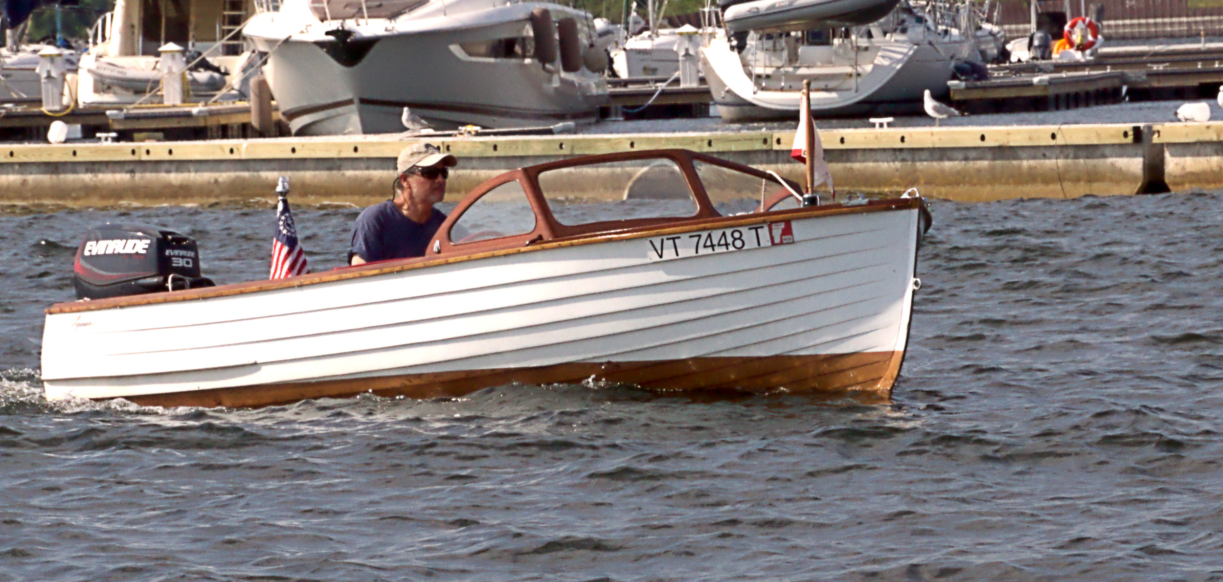 Doug Bell piloting Aqua Baby owned by Steve and Betsy Pond in the parade. Photo by John Dupee