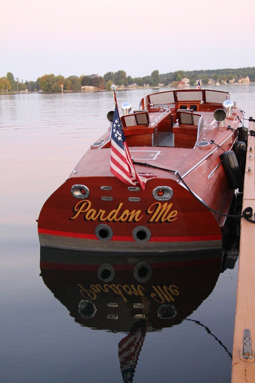 """""""Pardon Me"""" owned by the Antique Boat Museum, considered the largest runabout ever made, designed for commuting between Long Island and NYC.  Photo by Holly Weber"""