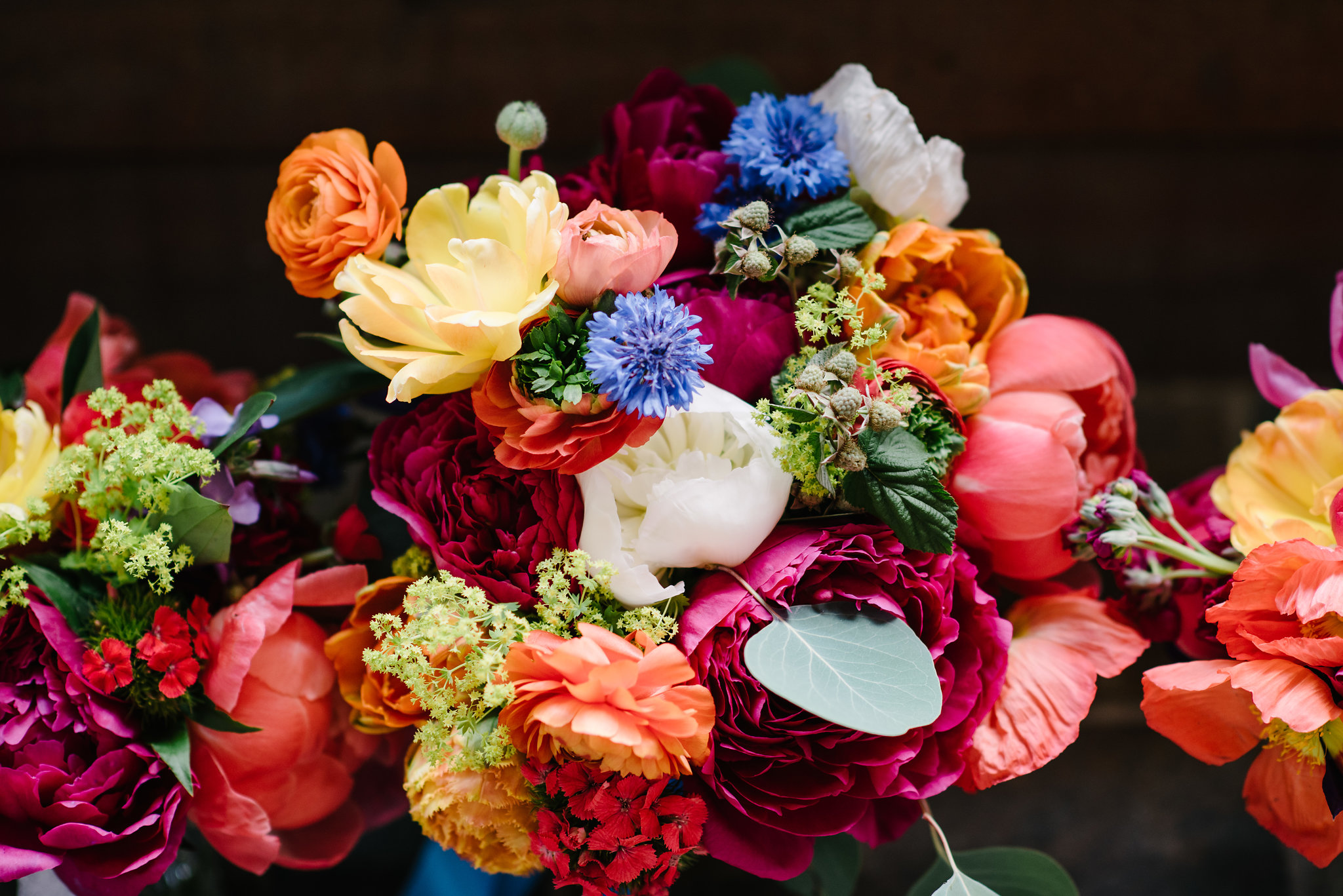 Photo by  Karissa Roe Photography of colorful wedding flowers