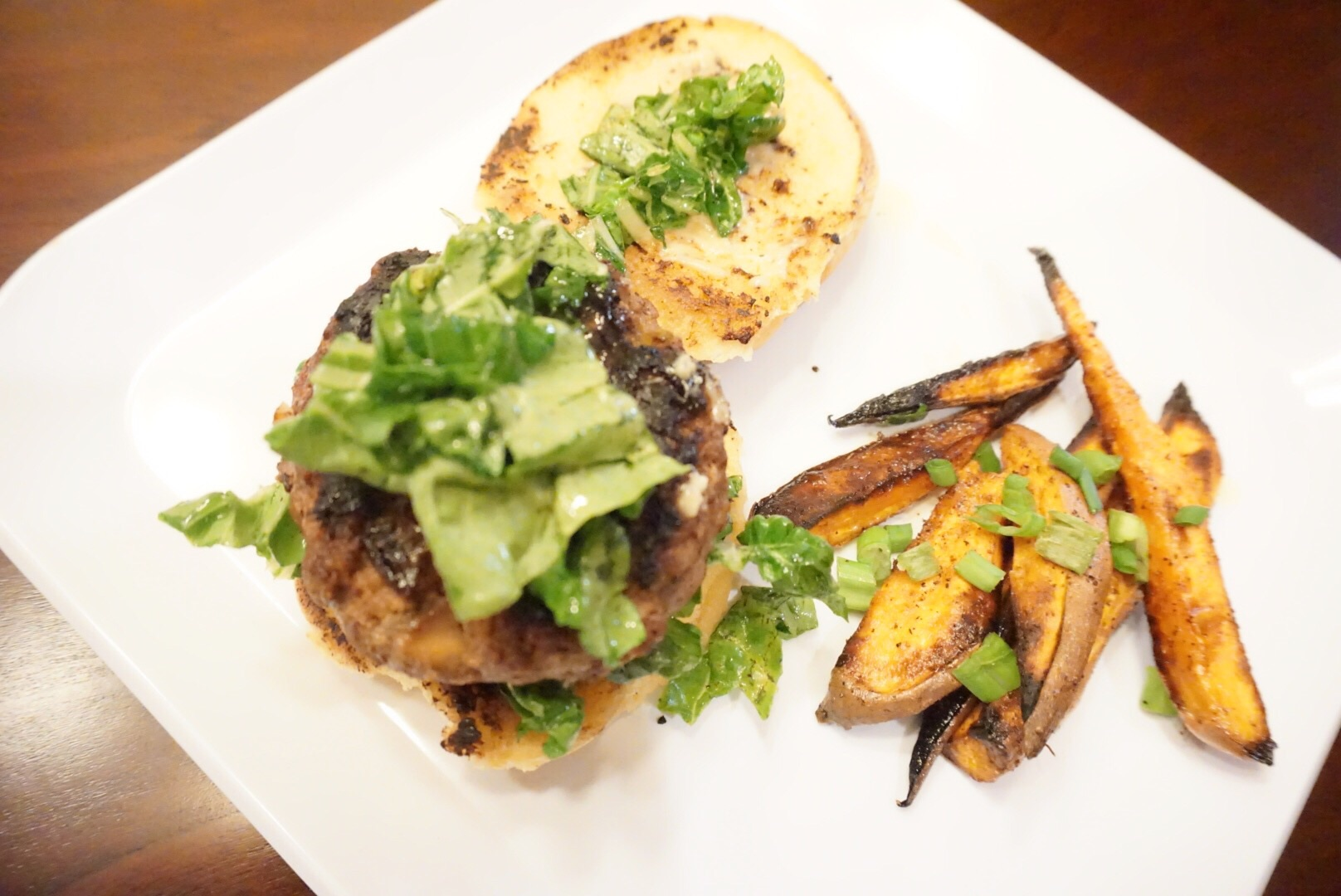 Shiitake & hoisin burger with sweet potato wedges.
