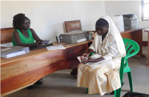 Janet, ALFI Fund beneficiary, discussing her loan needs with our Business Development Officer