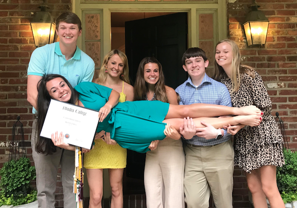 Caroline being held up after her graduation from Rhodes College by 5 out of her 7 siblings!