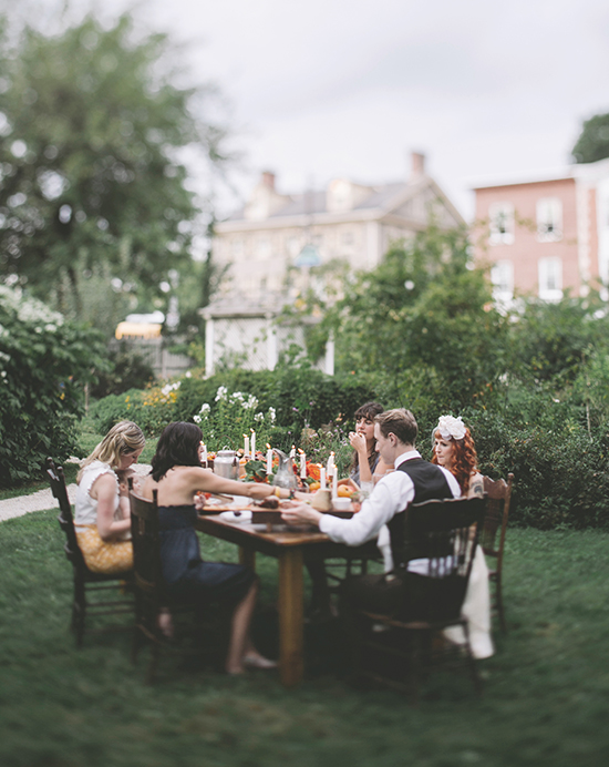Photo by Love Me Do Photography | Sarah Keel and Thom Berg sit down with friends to a meal by Birchtree Catering at the Wyck House.