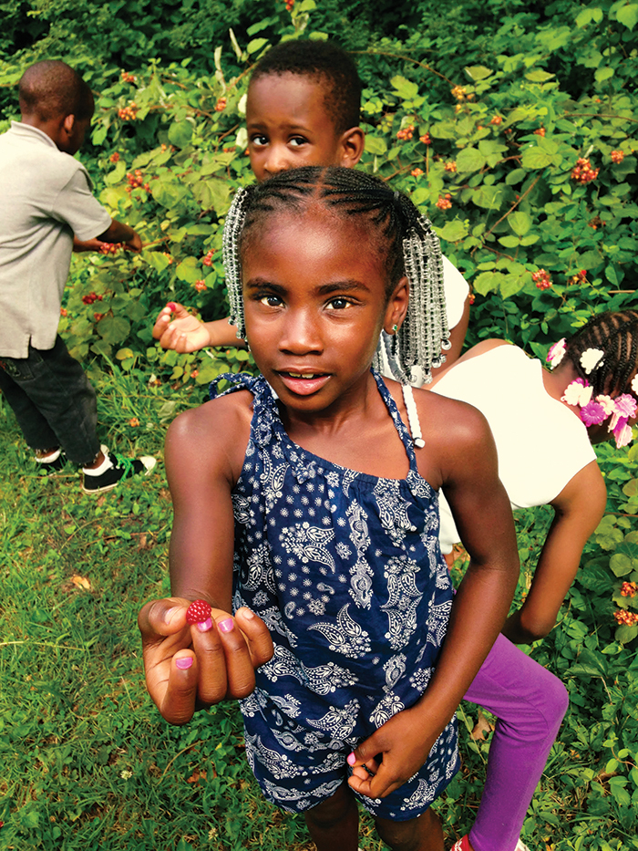Kids taking a hike with the Urban Blazers program learn which berries are edible |   photo by Urban Blazers