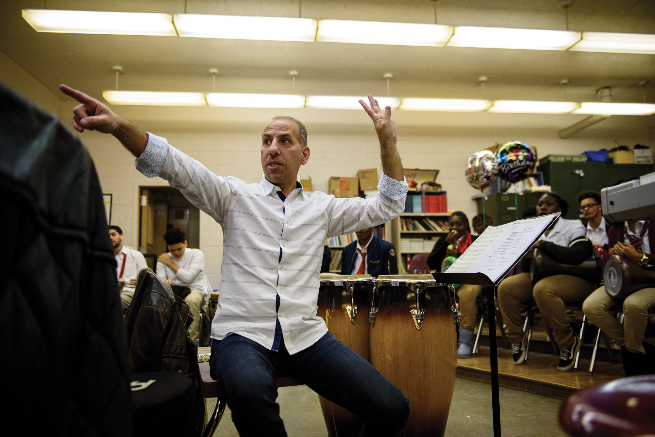 Hafez Kotain instructing a drum class at Northeast High School