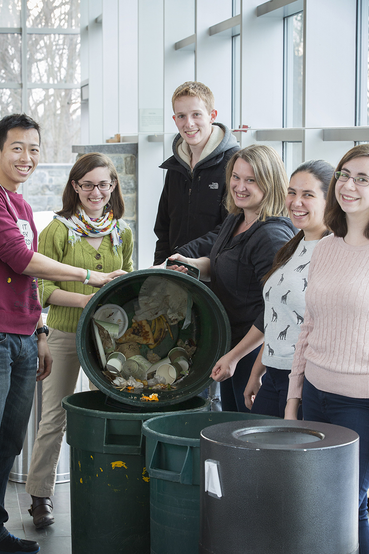 Melissa Tier, Sustainability Program Manager (2nd from left) and Aurora Winslade, Director of Sustainability (4th from left) sort compost at Swarthmore College, which composts organic waste in all dorms and office buildings. (Photo courtesy of Swarthmore College)