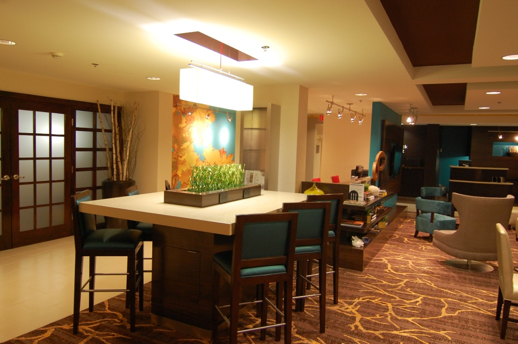 Marriott Courtyard Indy Lobby Communal Table & Library.JPG