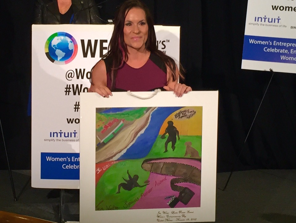 Dr. Jen Welter, the 1st female NFL coach with her Heart Map Award at the UN.