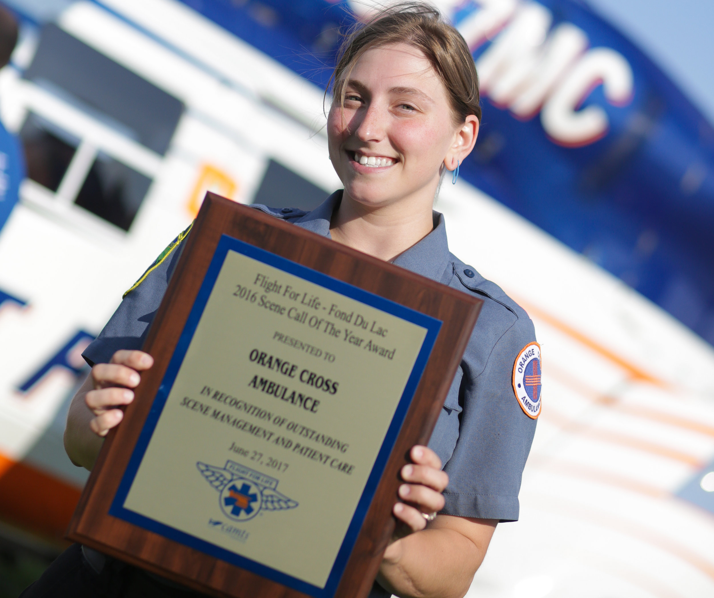 OCA Paramedic Taylor Green accepting the 2016 Fond Du Lac Base Flight for Life Scene Call of the Year Award for her demonstration of excellent care during a large motor vehicle accident.
