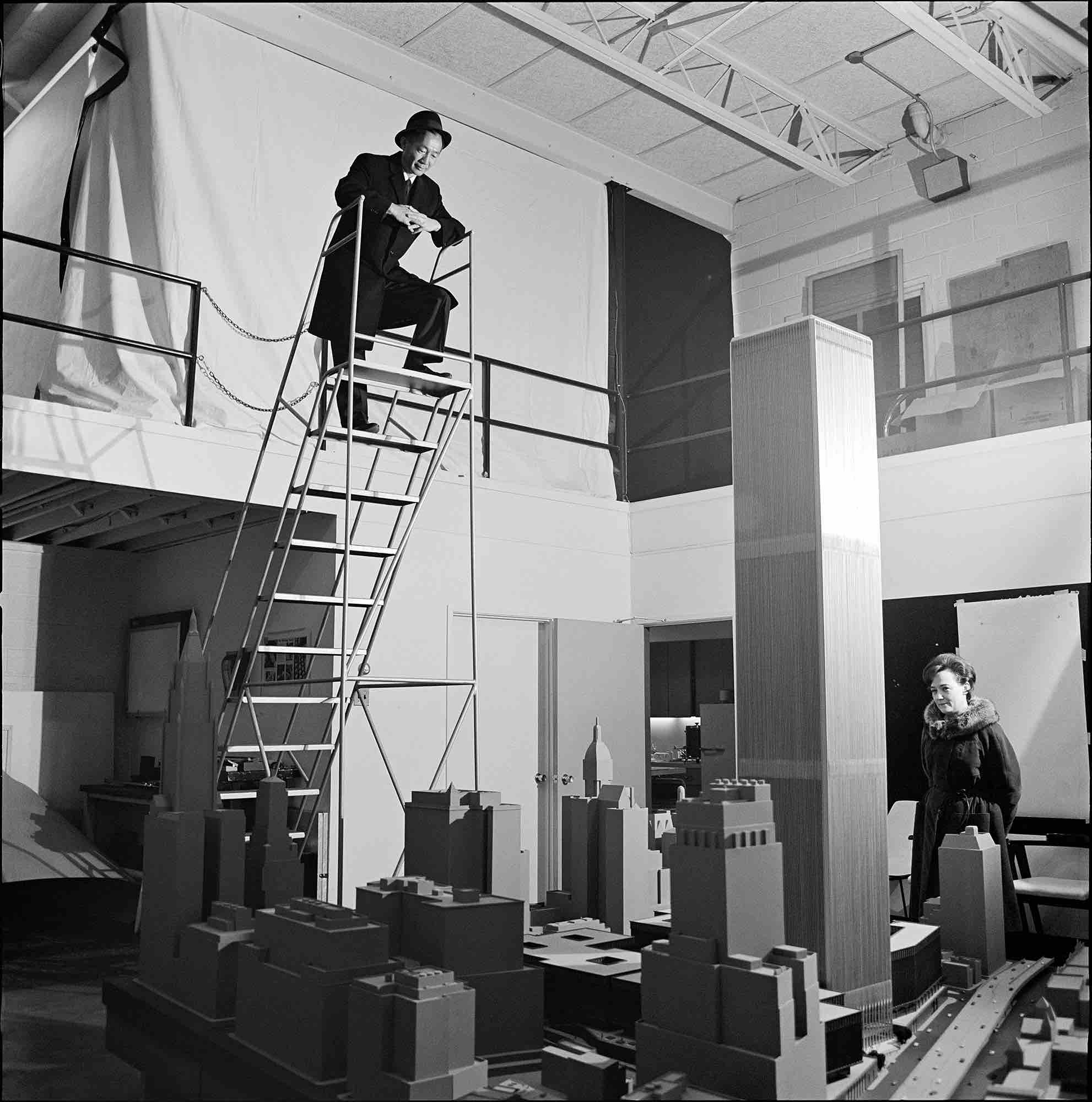 Minoru Yamasaki and his assistant reviewing his model for the World Trade Center, c. 1970