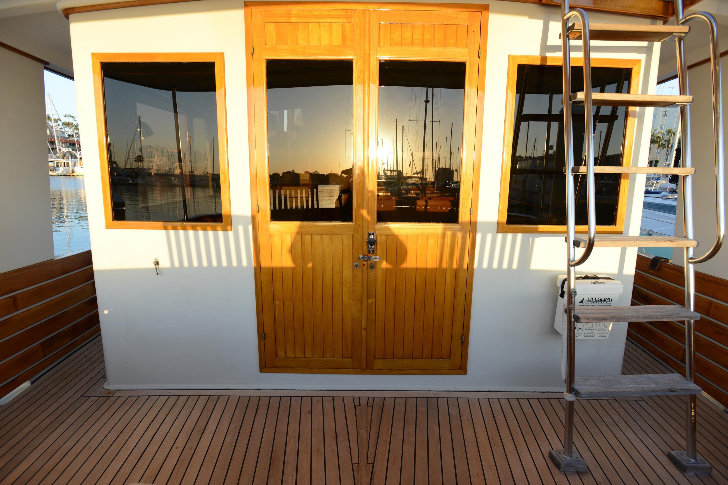rear salon entry is via teak double doors.JPG