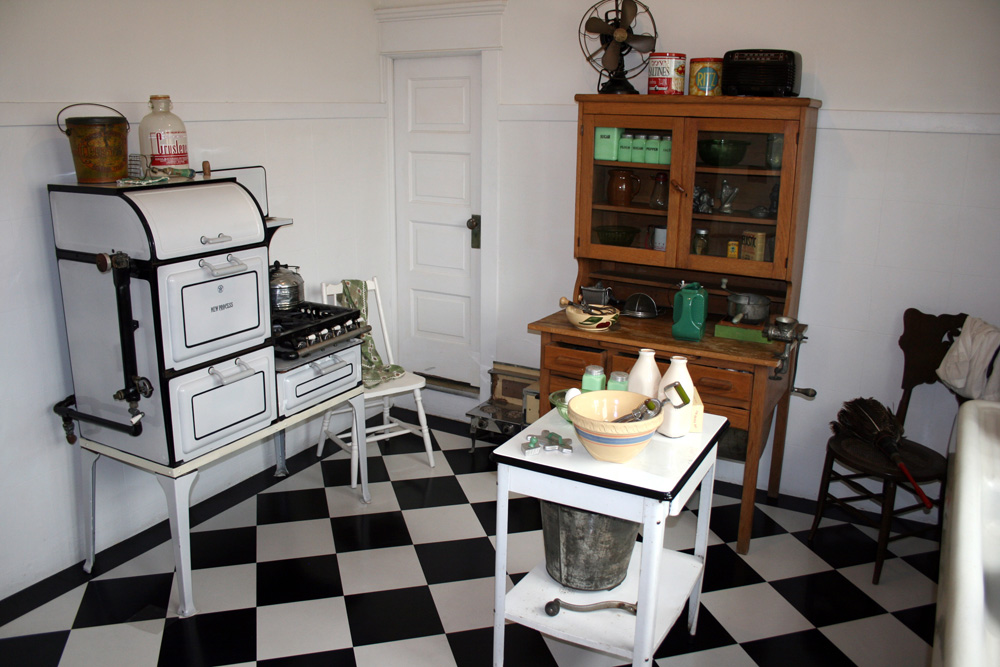 The narrow door in the kitchen leads to a small service stairway.