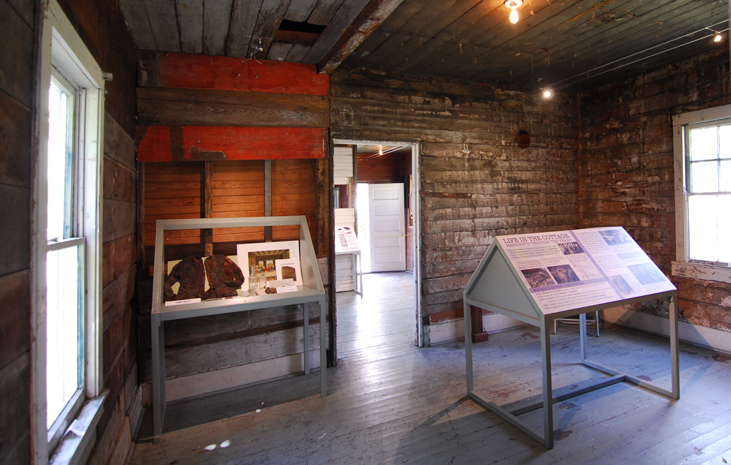 Interior of the middle room, where visitors can learn more about the cottage's residents through the years.