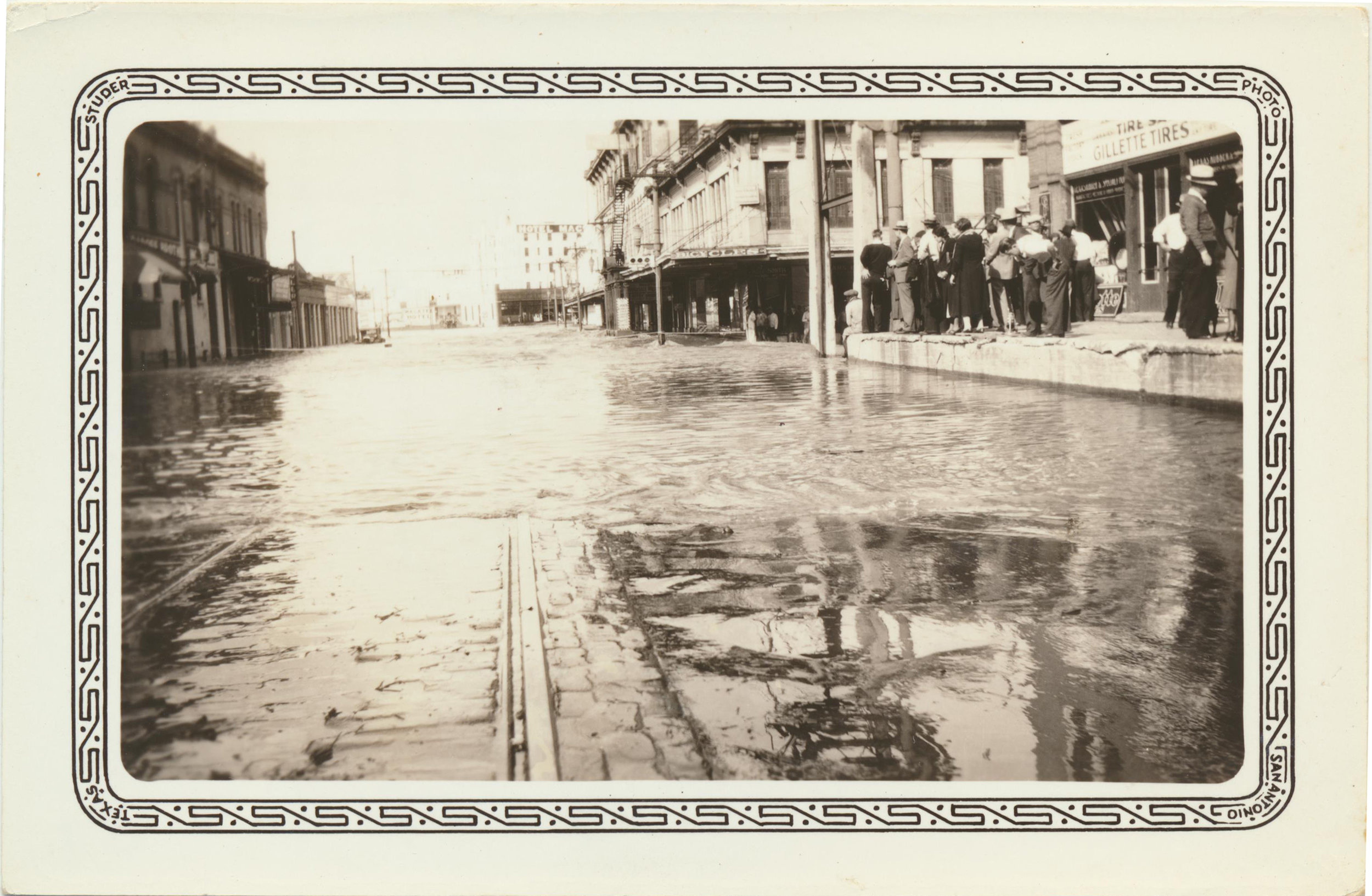 "December 8, 1935-this photo was taken on franklin avenue with the caption ""water rising high at midnight"""