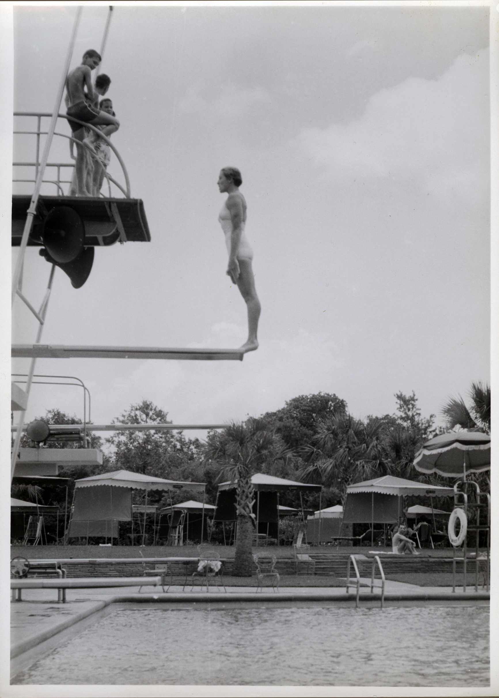 Diving at The Shamrock pool. Nancy Duty Cunningham, pictured here, began diving for The Shamrock in 1949 until 1957 at which time she started coaching. She remained as a diving coach there until 1973.  Photo Courtesy of Nancy Duty Cunningham.