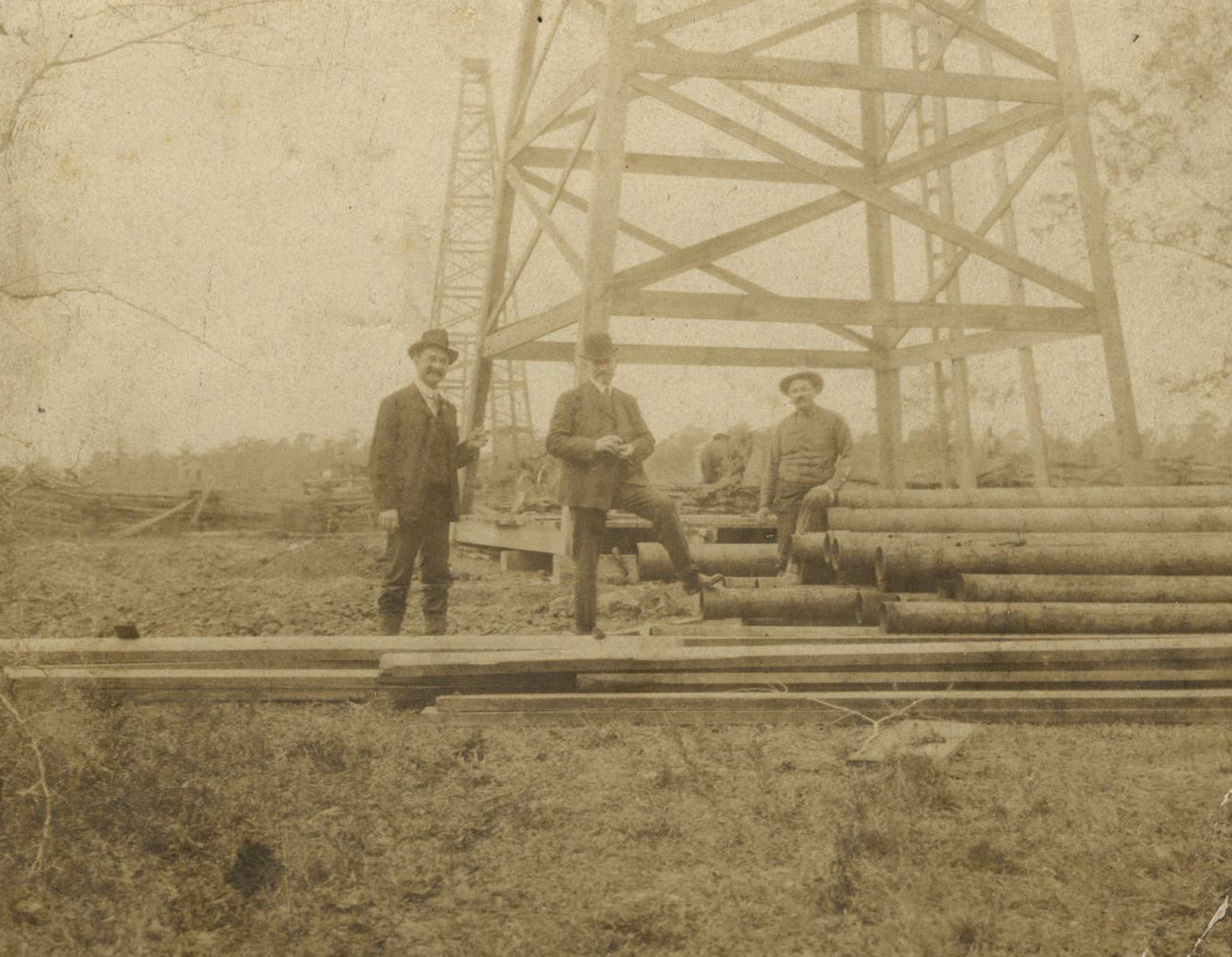 As a wildcatter or independent oilman, Henry (on the left) brought in some of the first wells in Humble in 1904 & 1905