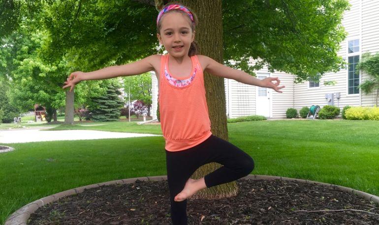 MINDBODYGREEN  -- A 5-Minute Yoga Wiggle & Wild Yoga Routine