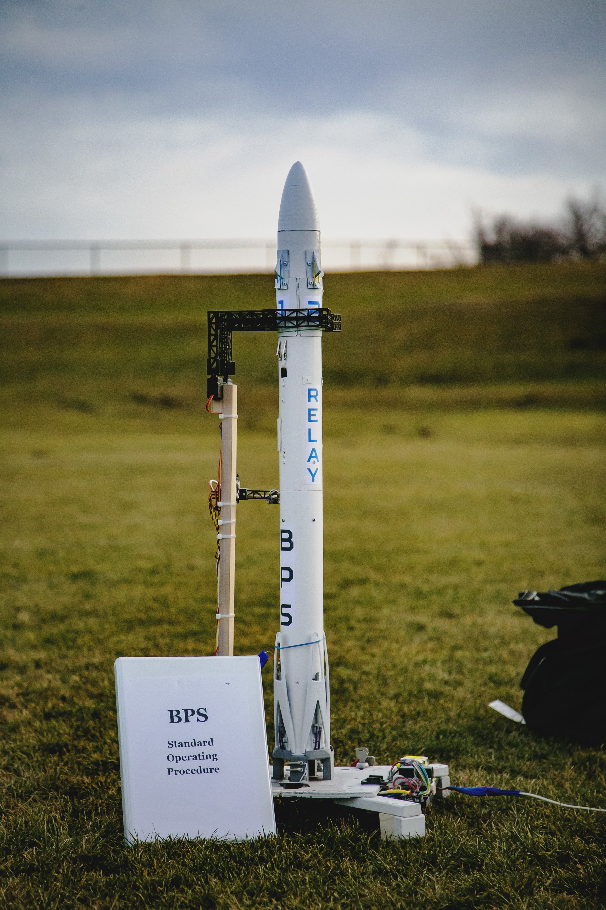 Relay F2 waits on the pad, next to the preflight and launch checklist binder