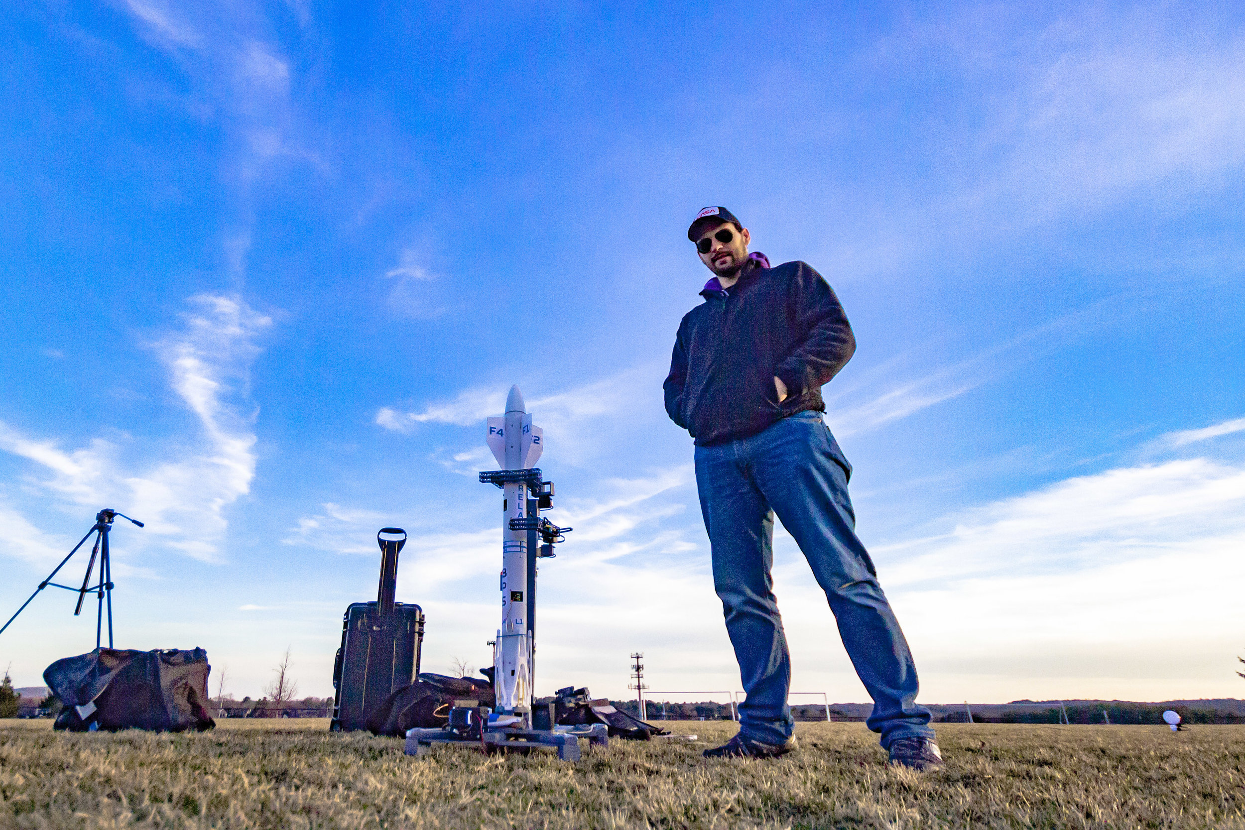 """EJ"" of the Eric Johnson Space Administration on Twitch stands next to Relay F3, sitting on Launch Pad 1.4"