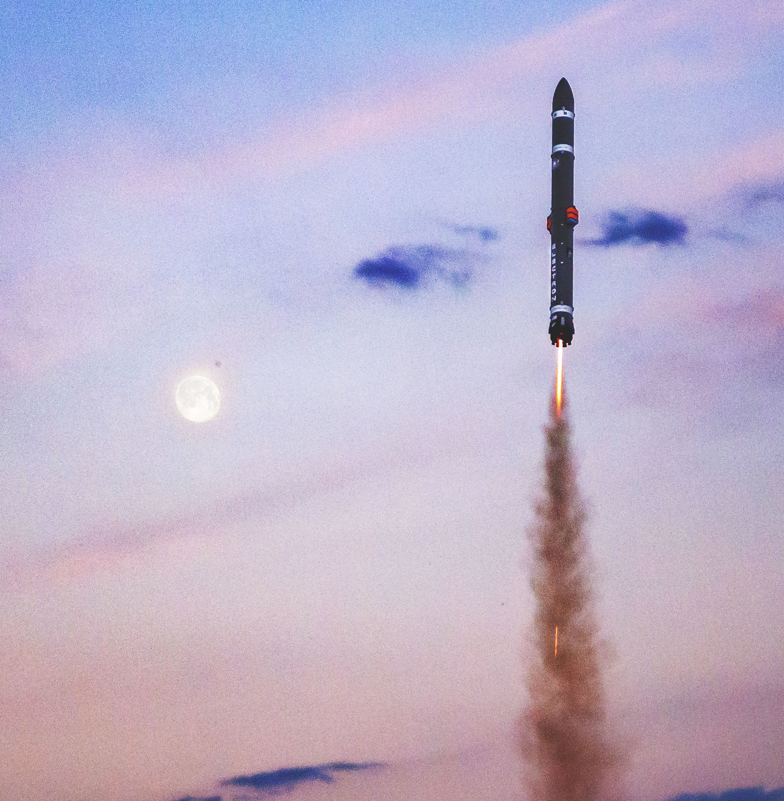 Electron soars past the moon at dusk