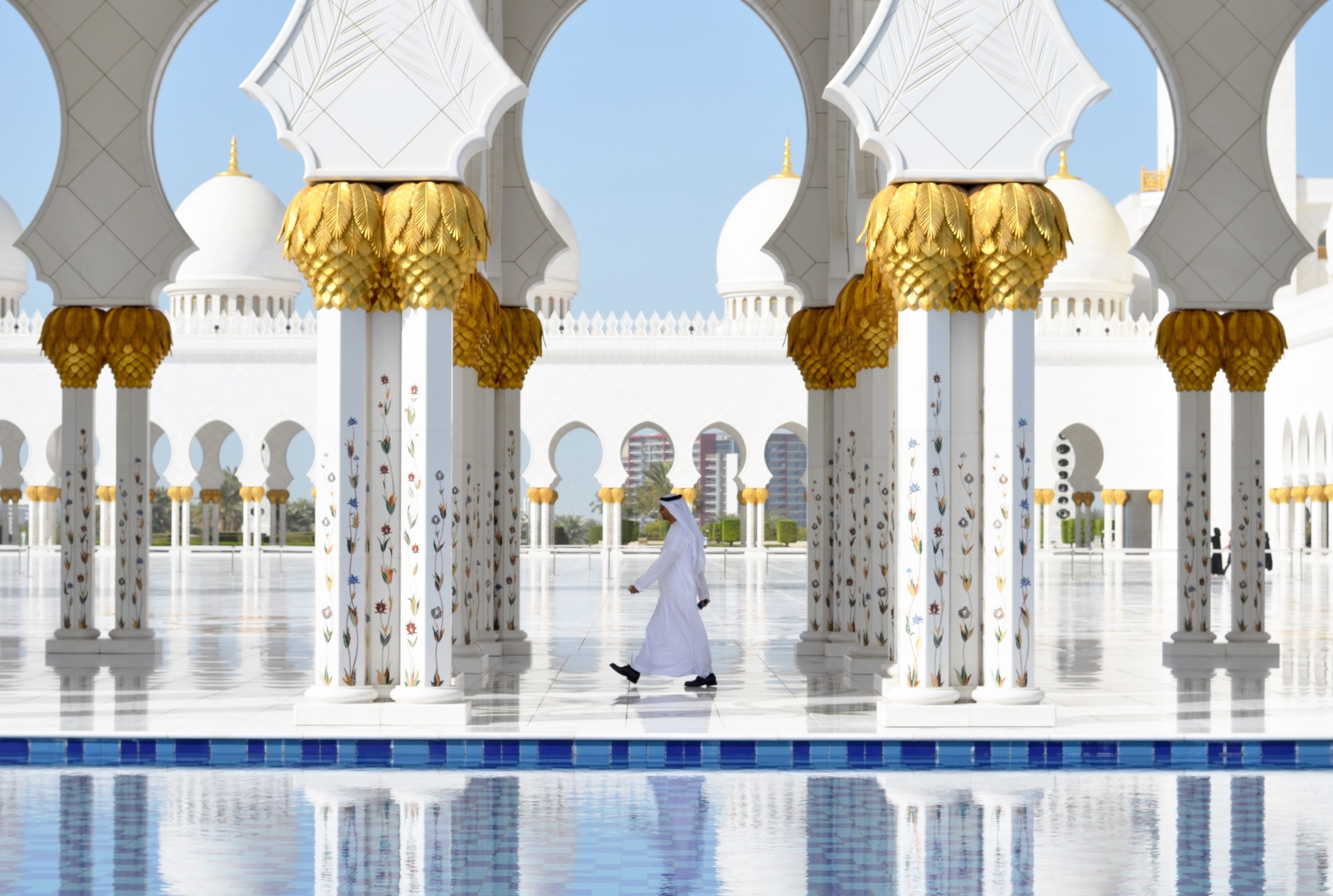 A local man walks in to the Sheikh Ziyad Grand Mosque in Abu Dhabi