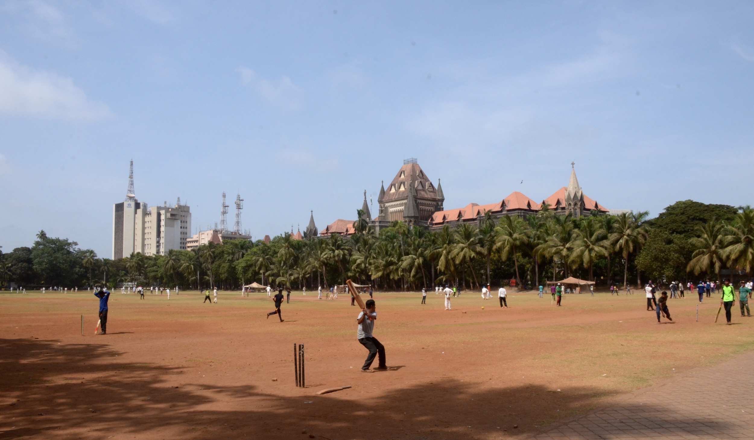Young Men practice the favorite local sport, Cricket