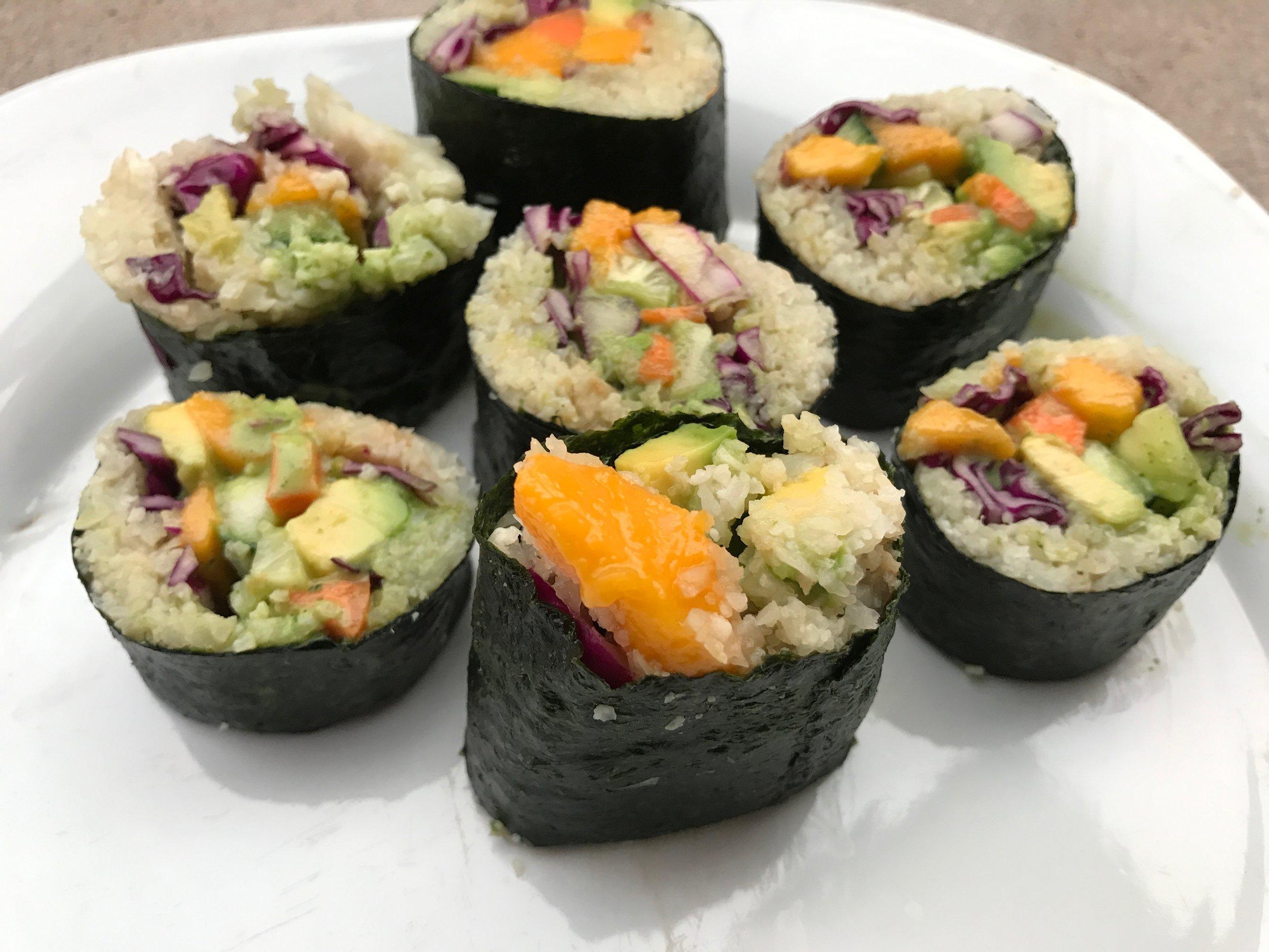 Ingredients: mango, purple cabbage, cauliflower rice, avocado, cucumber, carrot and  Myra Lesser 's green sauce