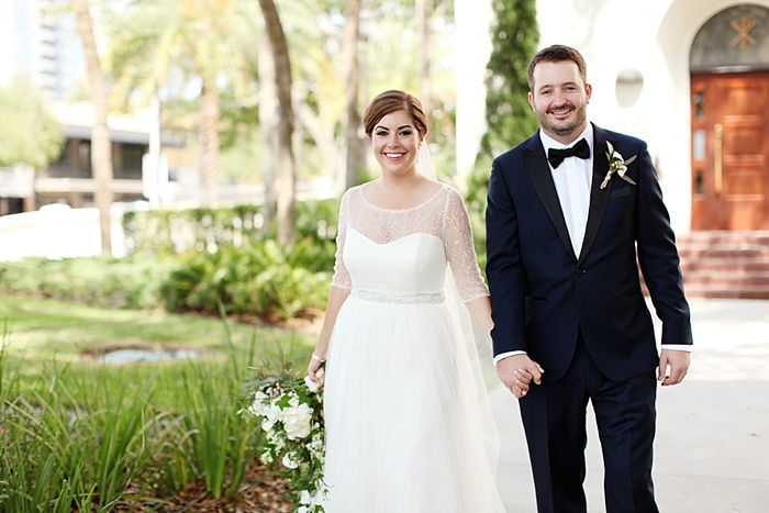glamorous black tie navy gold and peach downtown orlando wedding photography