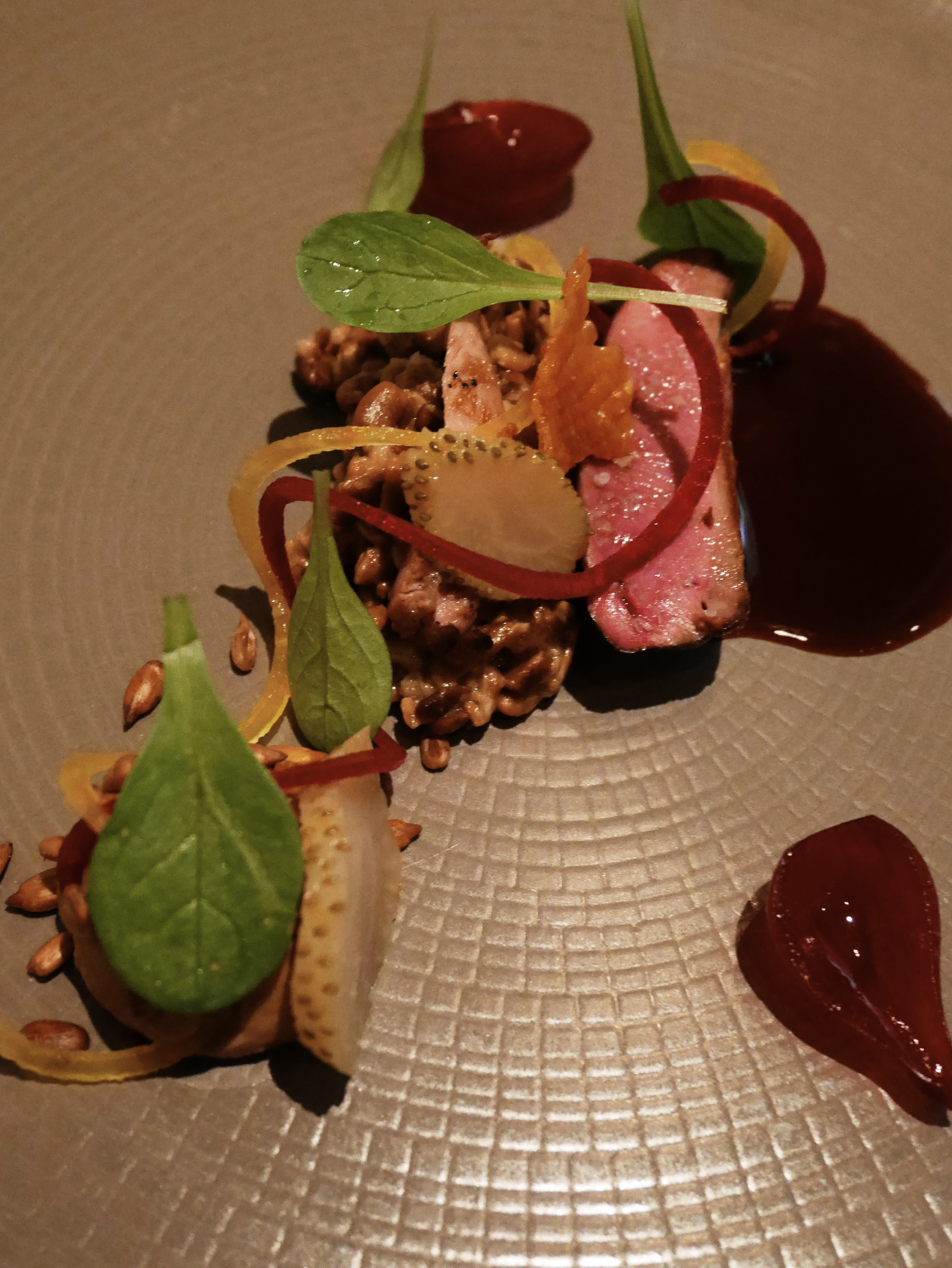 Squab, beet, green strawberries, sunflower seed, máche