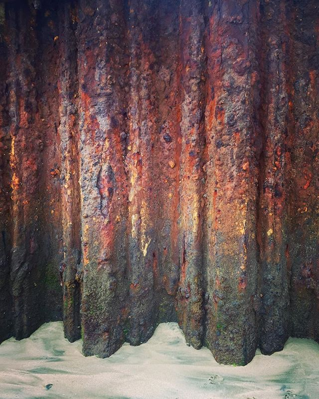 Found this steel curtain on a rainy day along the beach. You can find rainbows even in rust. #steel #curtain #beach #sand #vscocam #rust #playadelrey #ig #rainbow