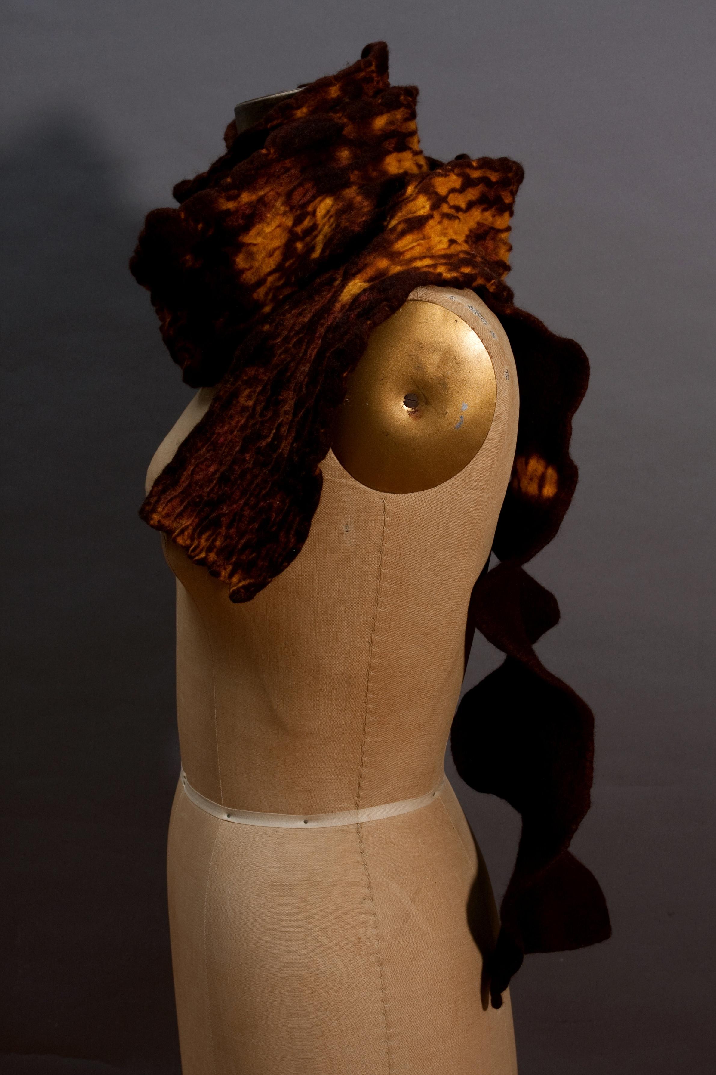 ten/mokume stitching on merino wool in browns