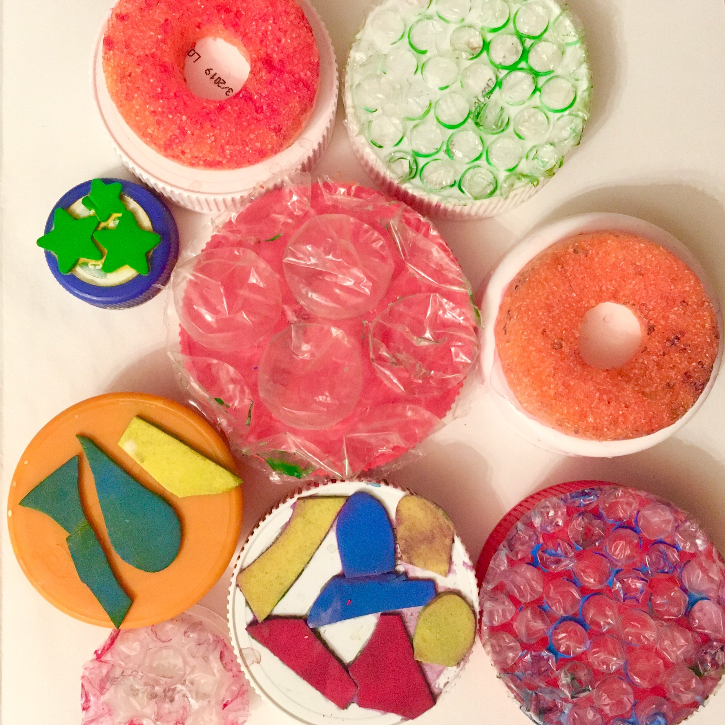 - My stamps include a slice of pool noodle, bubble wrap, foam star stickers, and foam scraps my children cut up.