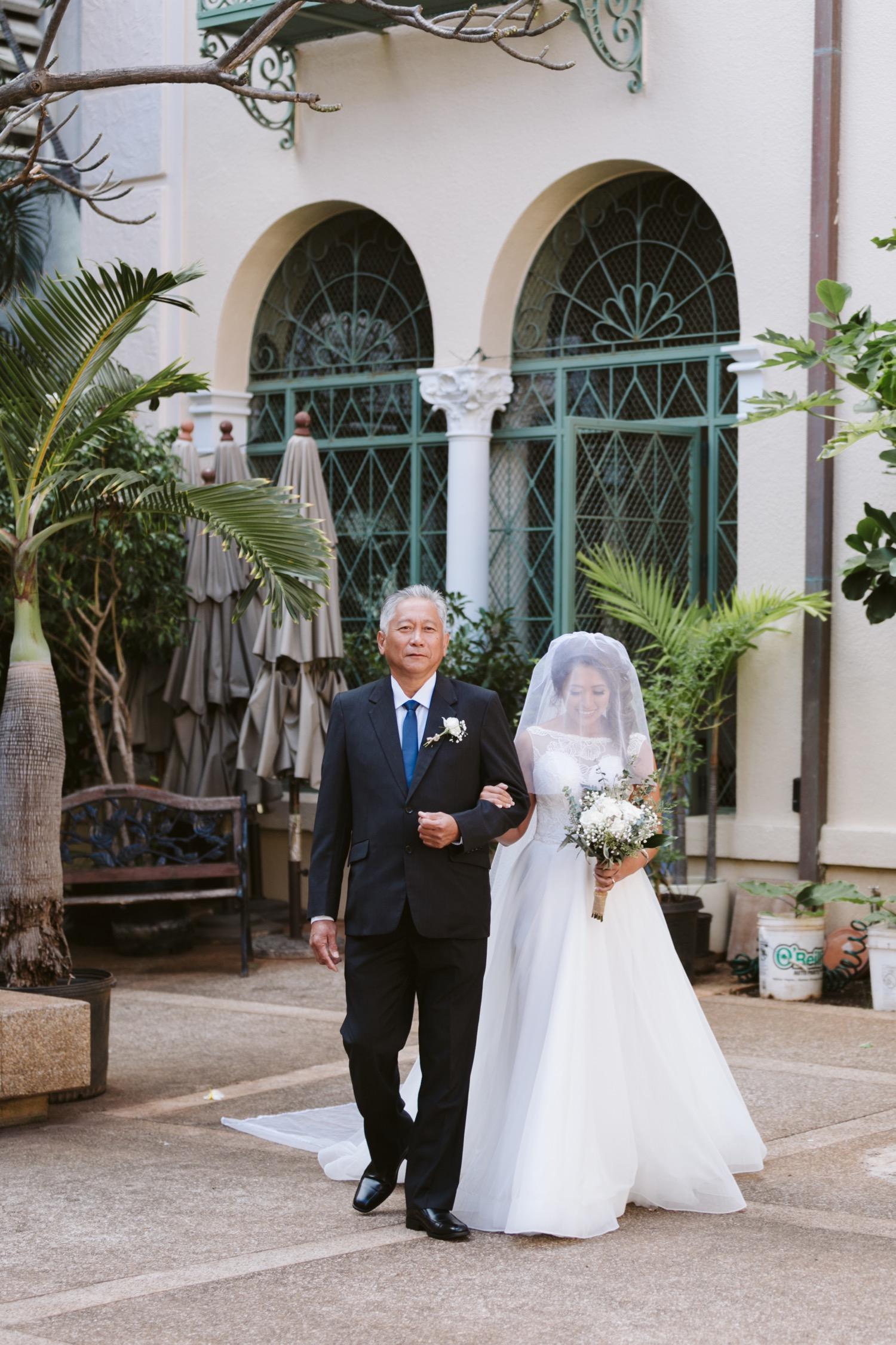 Julia_Hawaii_down_Ceremony_Bride_Honolulu_Cafe_Wedding_Walking_dad_aisle.jpg