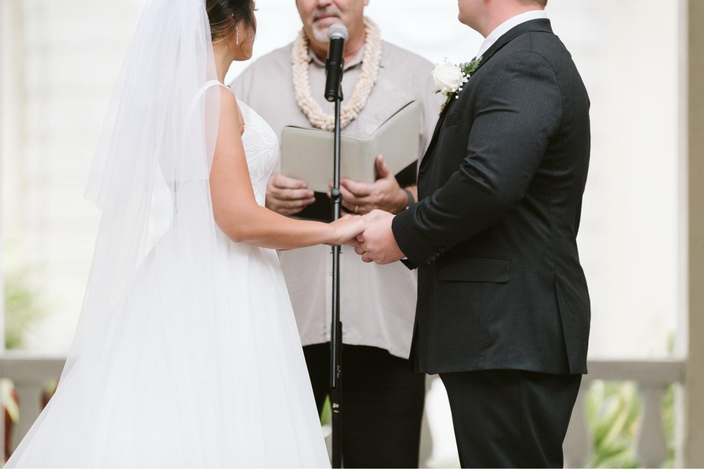 Julia_Vows_Hawaii_Groom_Ceremony_Honolulu_Wedding_Cafe_Bride_rings_officiant.jpg