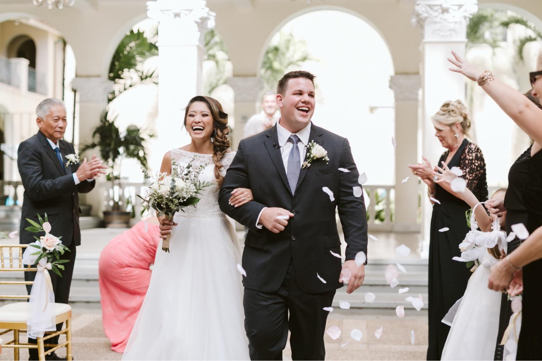 Julia_Groom_Hawaii_flower_Ceremony_Bride_Honolulu_Cafe_Wedding_petals_throw_toss.jpg