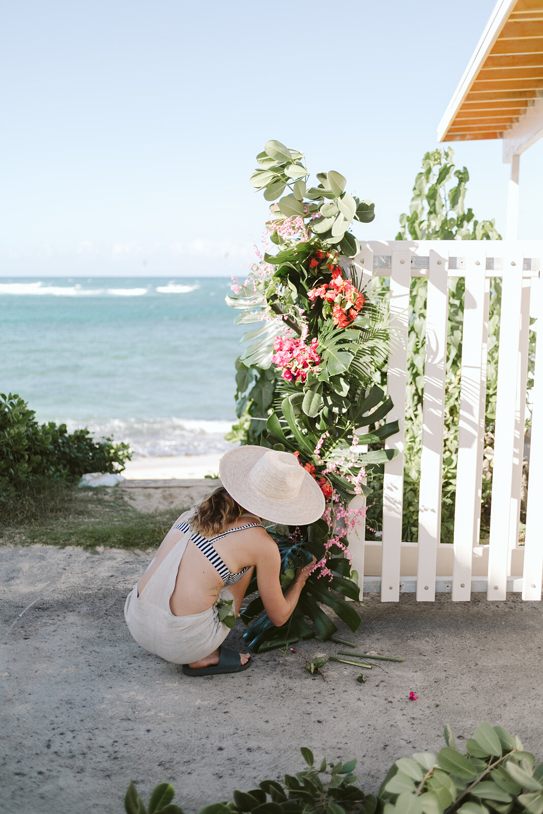 Mokuleia-North-Shore-Hawaii-Beach-House-Wedding-ceremony-arch-florals