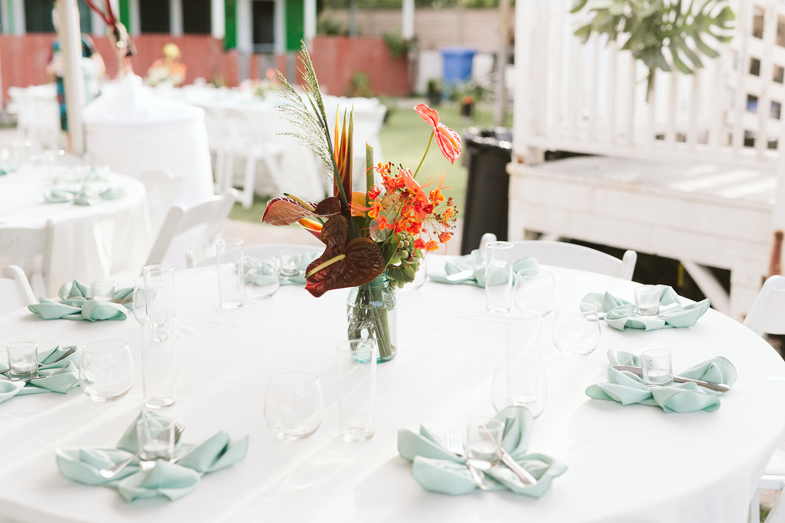 Mokuleia-North-Shore-Hawaii-Beach-House-Wedding-reception-details-floral-centerpieces