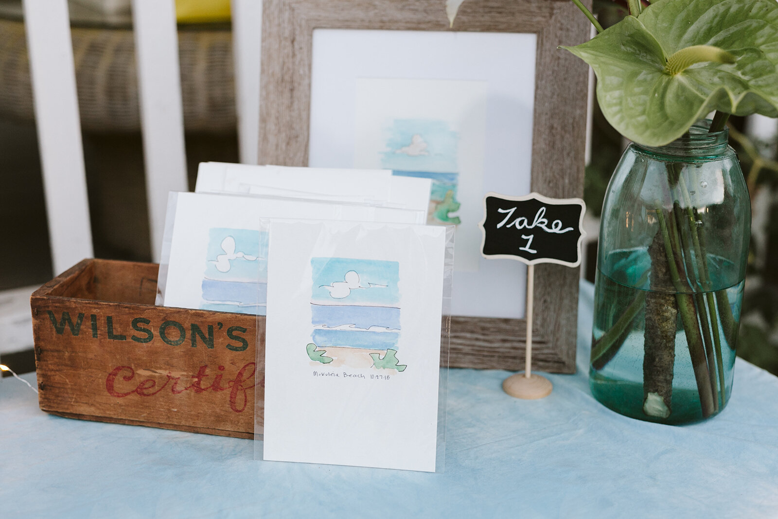 """The Bride painted these little cards herself! A little bit of the beach to take back with them. How sweet!"""