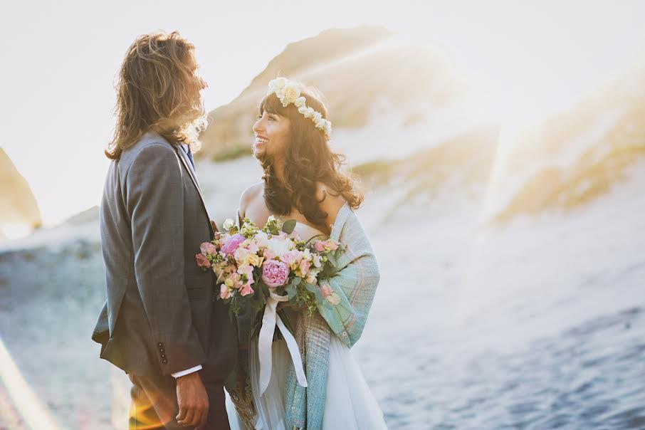 Bride and Groom at Pfeiffer Beach with Flowers by Kate Healey
