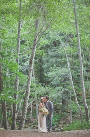 A Groom Kisses his Bride's Cheek in the Forests of Big Sur