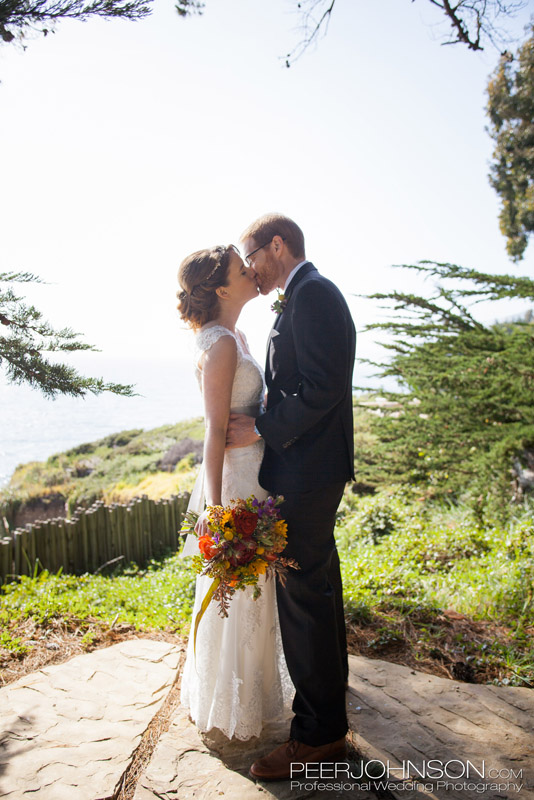 Bride and Groom Kissing by the Ocean