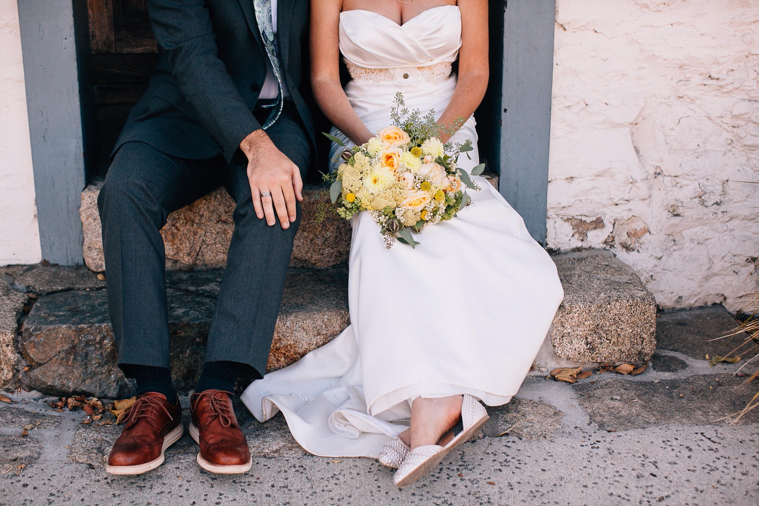 Couple Sitting Together with Bridal Bouquet