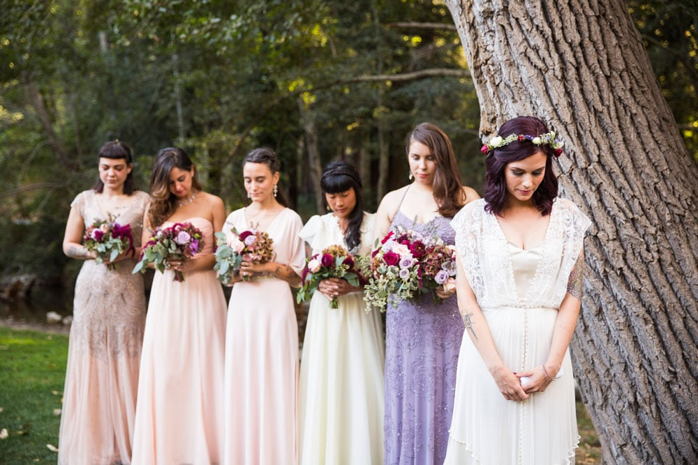 Lovely Bride in a Flower Crown and Bridesmaids Holding Bouquets