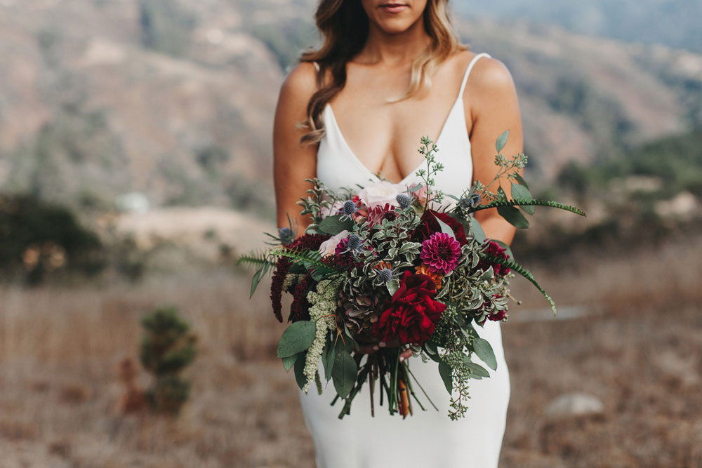 Bride in Big Sur Holding Large Wedding Bouquet by Kate Healey
