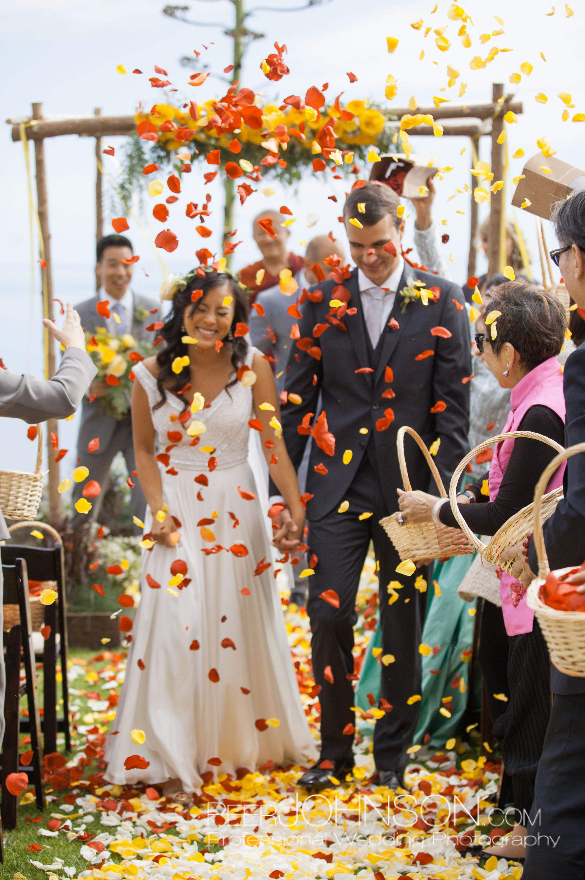 Bride and Groom Showered in Flower Petals