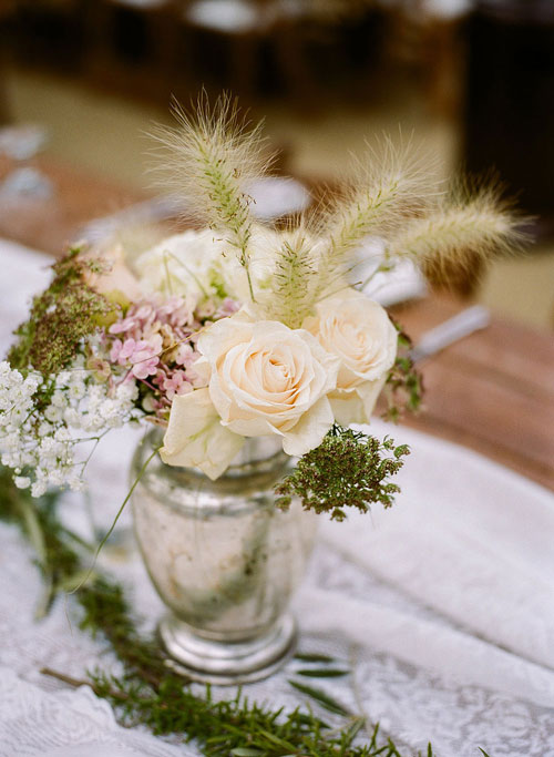 Wedding Dinner Table Decor with Silver Vase, White Roses, and Wildflowers