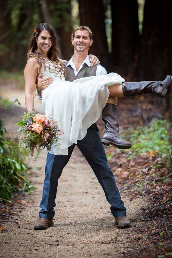 Groom Carries Bride with Bouquet by Big Sur Flowers