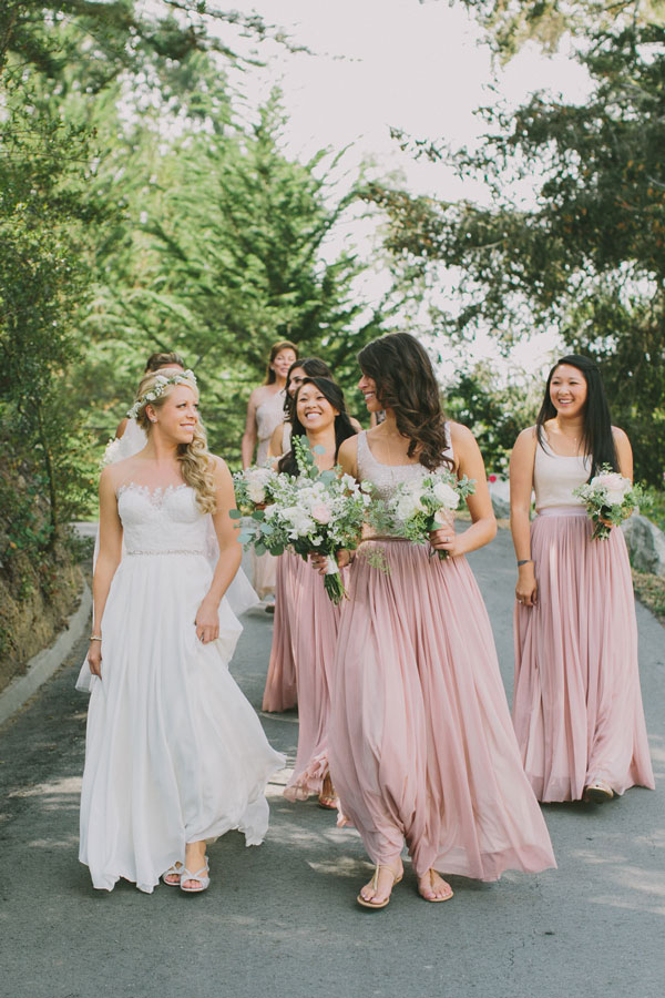 Bride and Bridesmaids Strolling with Flowers in Hand from Big Sur Flowers