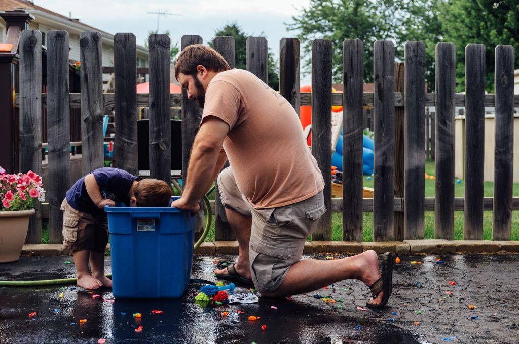 Nolan, left, fishes for water balloons.