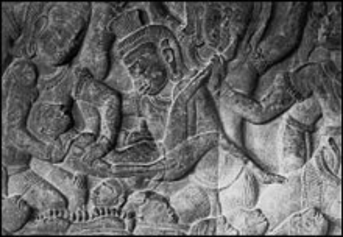 Bas-relief at Angkor Wat depicting a demon performing an ancient abortion.